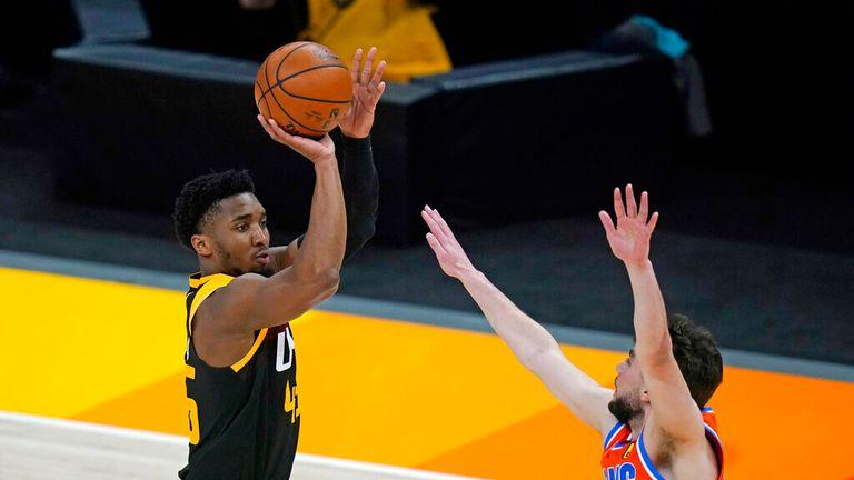 AP - Utah Jazz guard Donovan Mitchell shoots as Oklahoma City Thunder guard Ty Jerome defends