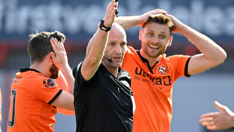 Ryan Edwards is in disbelief after Referee Bobby Madden waves off a penalty claim
