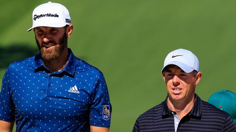 Rory McIlroy played a few practice holes with Dustin Johnson (left) on Monday