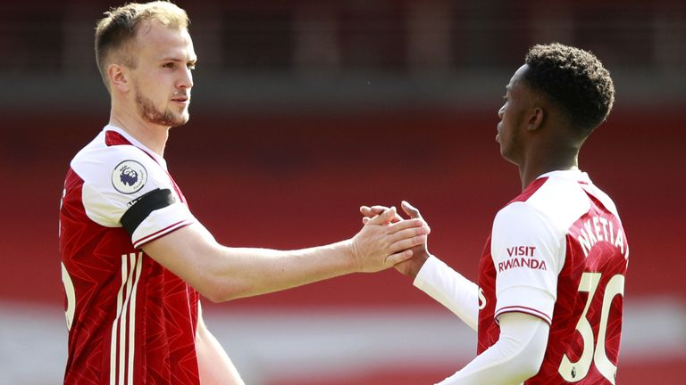 Rob Holding congratulates Eddie Nketiah after his late goal got Arsenal a draw against Fulham