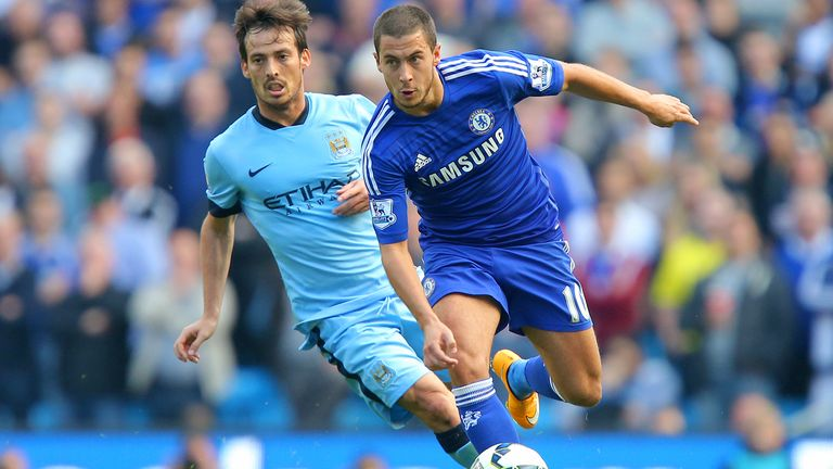 David Silva of Manchester City competes for the ball with Eden Hazard of Chelsea in 2014