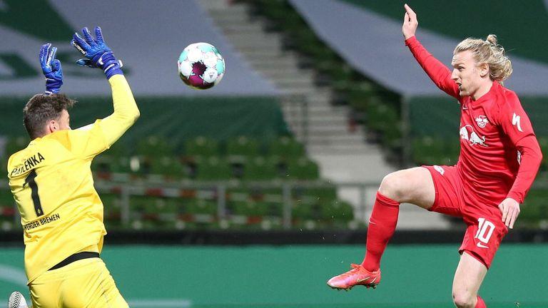 Emil Forsberg scores past Bremen's Czech goalkeeper Jiri Pavlenka to send RB Leipzig into the German Cup final