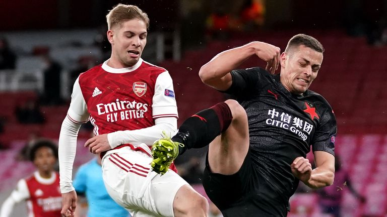 Emile Smith Rowe is denied a tap in by a last-ditch tackle after Alexandre Lacazette hit the bar