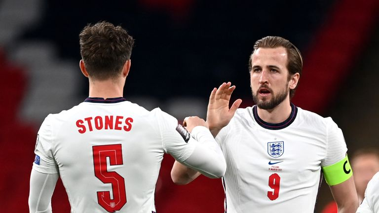 AP - Harry Kane congratulates John Stones after England's win over Poland