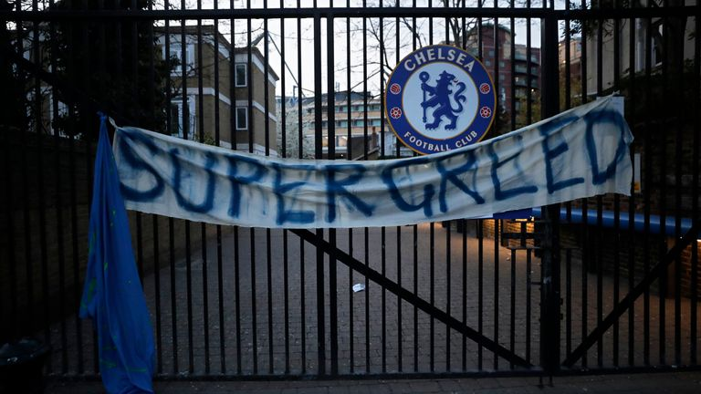 AP - 'Supergreed' banner outside Stamford Bridge