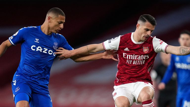 Richarlison closes down Granit Xhaka during a cagey opening half