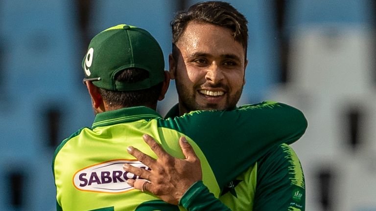 Pakistan's Faheem Ashraf, right, celebrates with captain Babar Azam after dismissing South Africa's George Linde