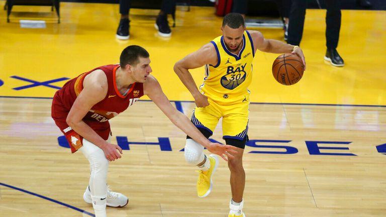 AP - Golden State Warriors' Stephen Curry, right, drives against Denver Nuggets' Nikola Jokic