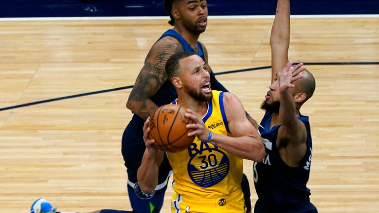 AP - Golden State Warriors' Stephen Curry (30) eyes the basket as Minnesota Timberwolves' Jordan McLaughlin (6) closes in