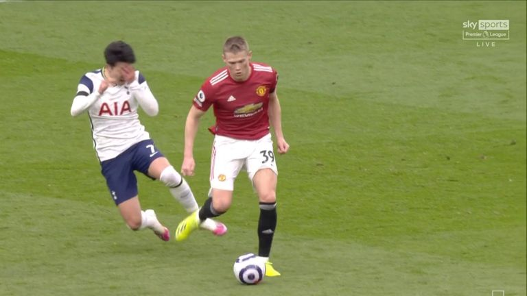 Heung-Min Son reacts after a clash with Scott McTominay that referee Chris Kavanagh retrospectively ruled a foul after going to the pitchside monitor