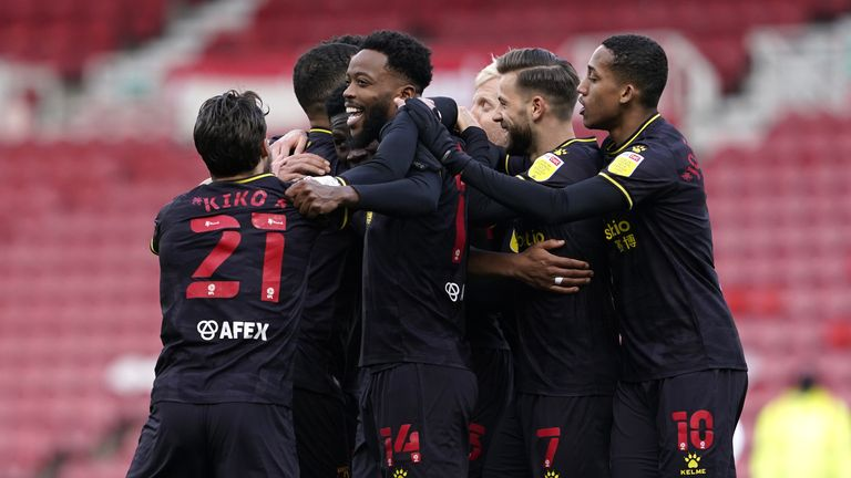 Watford's Ismaila Sarr is mobbed by team-mates after putting them 1-0 up