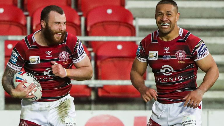Wigan's Jake Bibby (L) celebrates his third try with Willie Isa