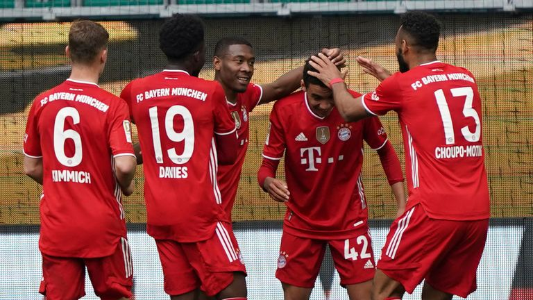 Jamal Musiala is congratulated after scoring for Bayern Munich