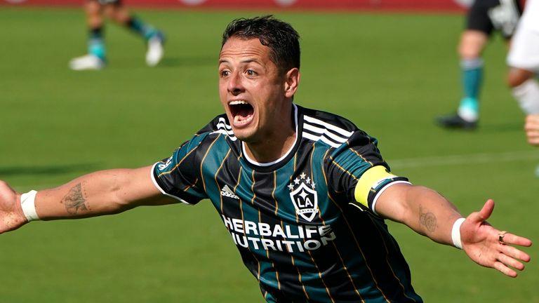 Javier Hernandez wheels away in delight to celebrate his second strike