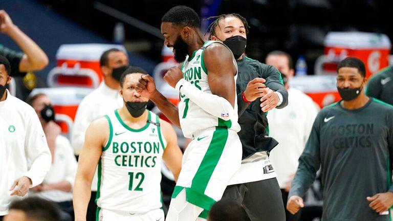AP - Boston Celtics guard Jaylen Brown, front left, celebrates with guard Carsen Edwards