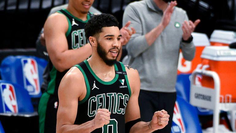AP - Boston Celtics forward Jayson Tatum rects as the buzzer sounds