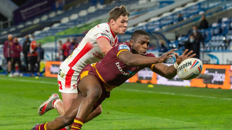 Jermaine McGillvary attempts to ground the ball to prevent St Helens's Jack Welsby scoring a try