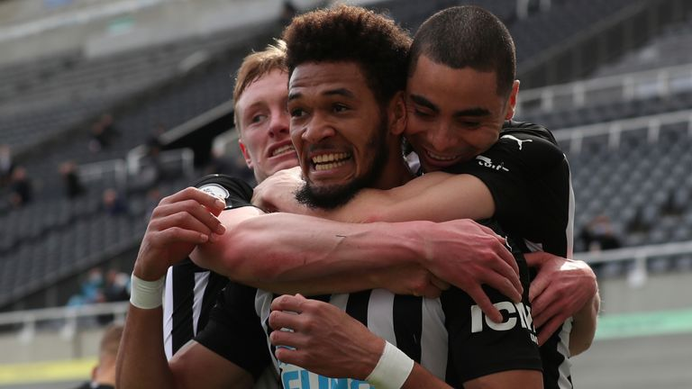 Joelinton celebrates after putting Newcastle ahead against Tottenham