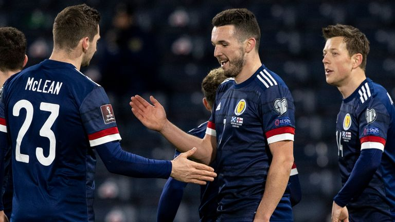 GLASGOW, SCOTLAND - MARCH 31: Scotland's John McGinn celebrates his second goal with Kenny McLean during a World Cup qualifier between Scotland and the Faroe Islands at Hampden Park, on March 31, 2021, in Glasgow, Scotland. (Photo by Craig Williamson / SNS Group)