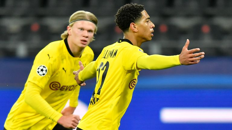 Dortmund's Jude Bellingham, right, celebrates after scoring his side's first goal during the Champions League quarterfinal second leg soccer match between Borussia Dortmund and Manchester City at the Signal Iduna Park stadium in Dortmund