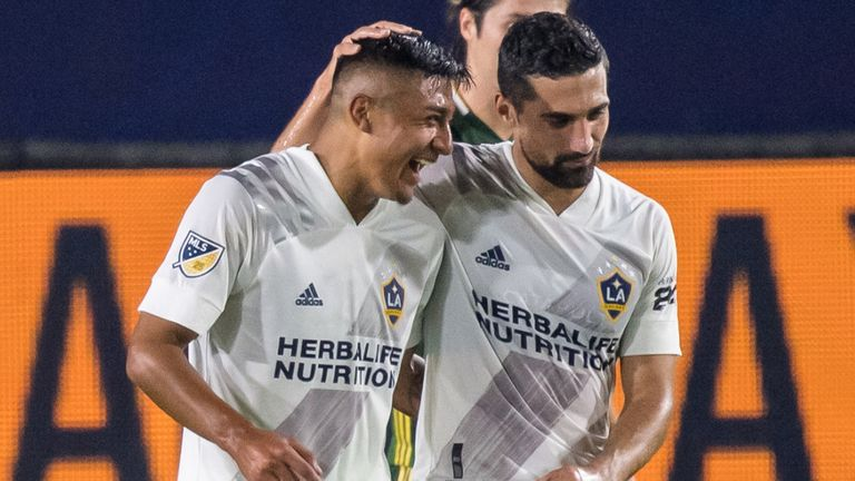 CARSON, CA - OCTOBER 7:  Julian Araujo #22 of Los Angeles Galaxy celebrates his goal with Sebastian Lletget #17 of Los Angeles Galaxy during the Los Angeles Galaxy's MLS match against Portland Timbers at the Dignity Health Sports Park on October 7, 2020 in Carson, California.  Portland Timbers won the match 6-3  (Photo by Shaun Clark/Getty Images) *** Local Caption ***  Julian Araujo ;Sebastian Lletget