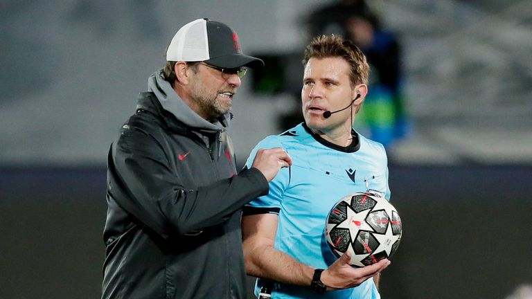 Jurgen Klopp of Liverpool FC talking to referee Felix Brych during the UEFA Champions League match between Real Madrid v Liverpoo
