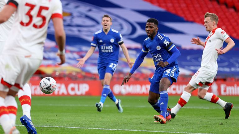 Iheanacho guides his shot into the net for Leicester on Sunday