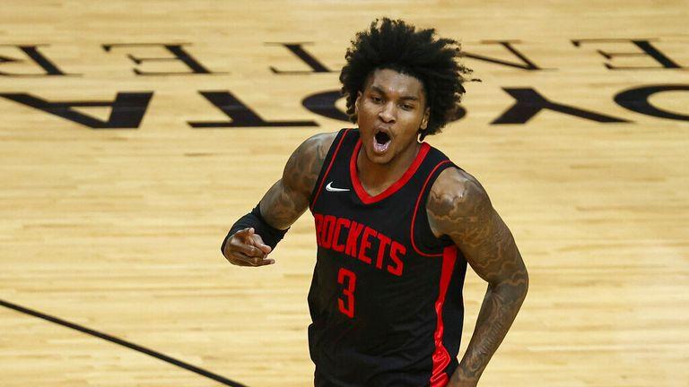 AP - Houston Rockets guard Kevin Porter Jr. (3) reacts after making a basket