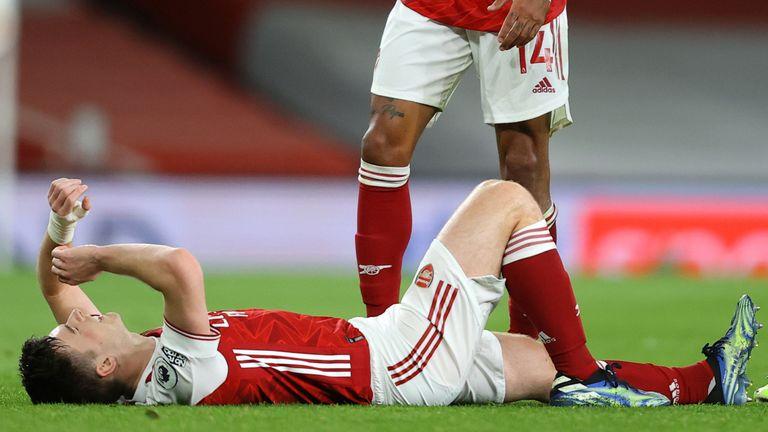 Kieran Tierney lies injured before receiving treatment on his left knee