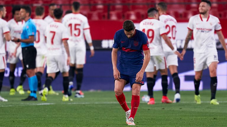 Atletico's title charge was dealt a blow with defeat at Sevilla on Sunday