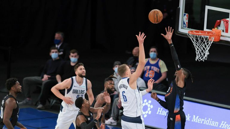 Dallas Mavericks center Kristaps Porzingis shoots over New York Knicks center Nerlens Noel