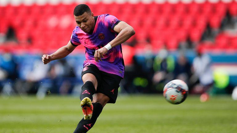 Kylian Mbappe takes a free kick against Saint-Etienne at Parc Des Princes