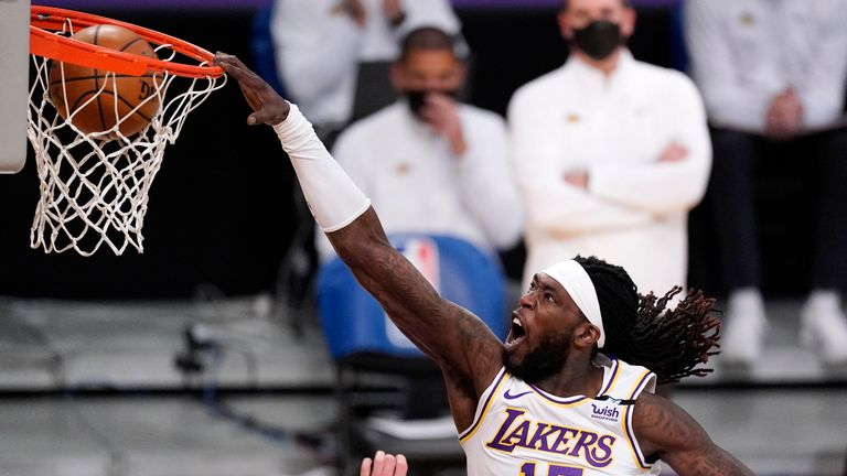 Los Angeles Lakers center Montrezl Harrell dunks during the second half of an NBA basketball game against the Utah Jazz Saturday, April 17, 2021, in Los Angeles. (AP Photo/Mark J. Terrill)