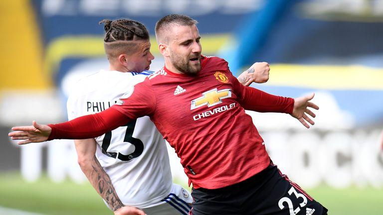 Leeds United's Kalvin Phillips challenges Manchester United's Luke Shaw