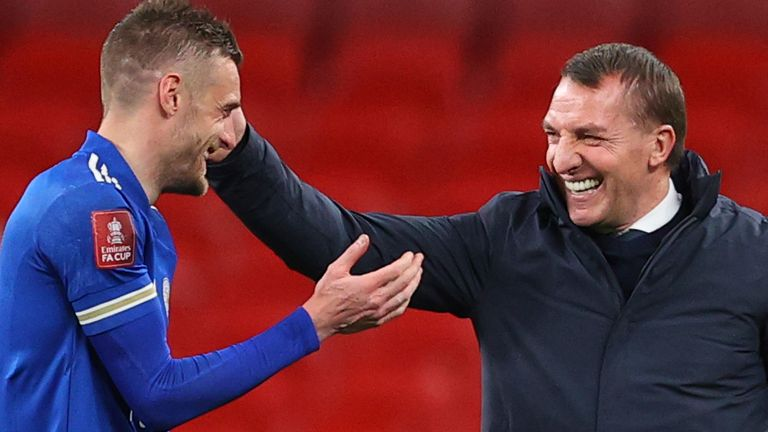 Leicester's Jamie Vardy, left, celebrates with Leicester's manager Brendan Rodgers at the end of the English FA Cup semifinal soccer match between Leicester City and Southampton at Wembley Stadium in London, Sunday, April 18, 2021.