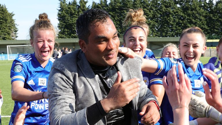 Leicester City Women manager Jonathan Morgan celebrates promotion to the WSL with his players