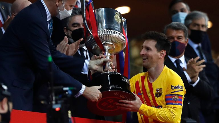 Lionel Messi collects the Copa del Rey after Barcelona's 4-0 win