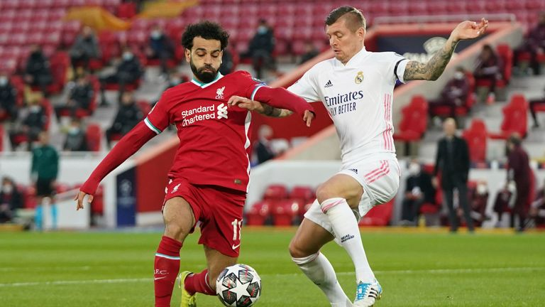 Mohamed Salah, left, fights for the ball with Real Madrid's Toni Kroos