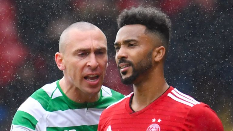 04/05/19 LADBROKES PREMIERSHIP .ABERDEEN v CELTIC .PITTODRIE - ABERDEEN .Celtic captain Scott Brown exchanges words with Aberdeen...s Shay Logan after the defender is booked.