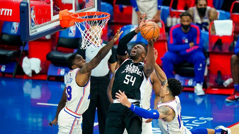 AP - Los Angeles Clippers' Patrick Patterson, center, tries to get a shot past Philadelphia 76ers' Shake Milton, left, and Danny Green