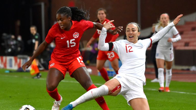 AP - Lucy Bronze battles for the ball against Canada
