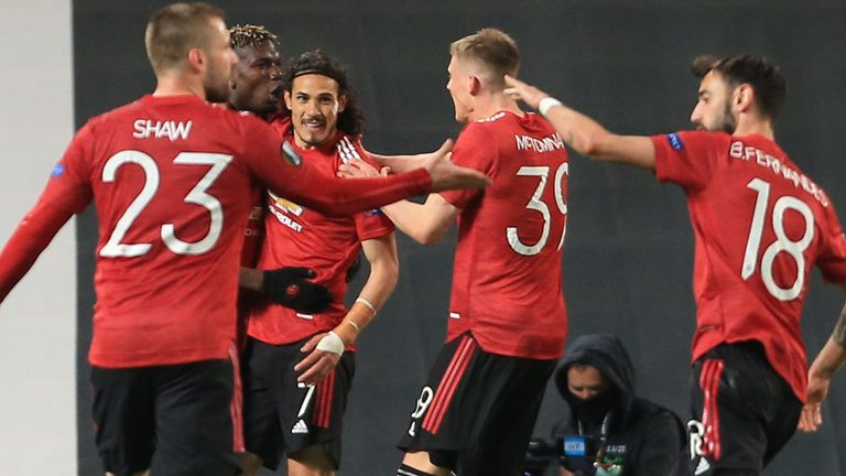 Man Utd players celebrate Edinson Cavani putting them ahead against Roma