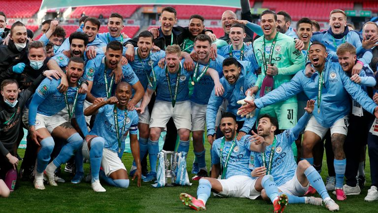 Manchester City players celebrate with the trophy after defeating Spurs 1-0 in the Carabao Cup final (AP)