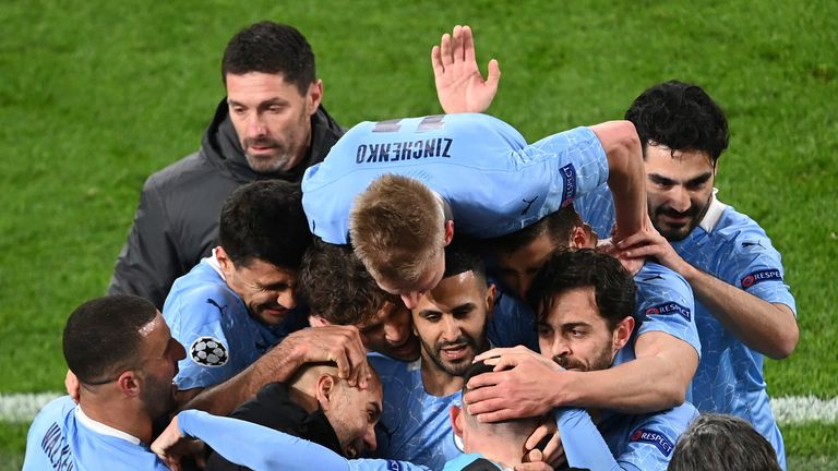AP - Manchester City celebrate making it to the Champions League semi-finals