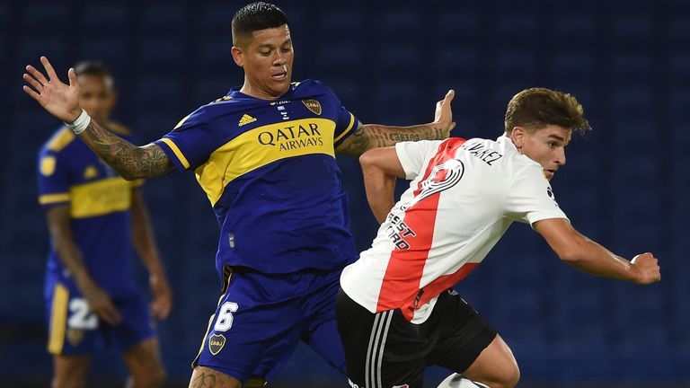 Marcos Rojo of Boca Juniors, left, Julian Alvarez of River Plate battle for the ball during a local league soccer match at the Bombonera stadium in Buenos Aires, Argentina, Sunday, March 14, 2021.(Marcelo Endelli/Pool via AP)