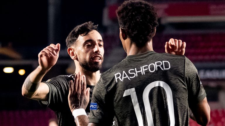 Marcus Rashford celebrates with Bruno Fernandes after opening the scoring against Granada
