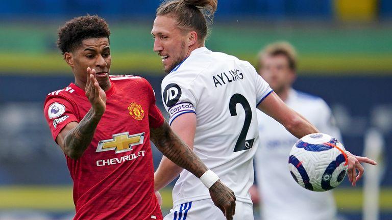 Marcus Rashford and Luke Ayling in Premier League action (AP)