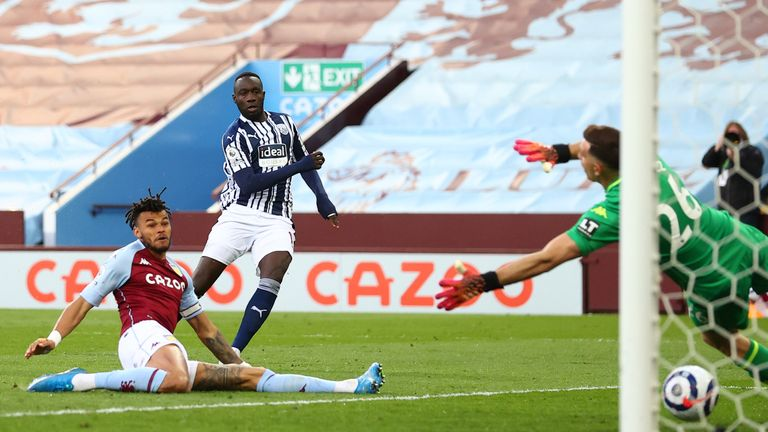 Mbaye Diagne's shot deflects off the leg of Tyrone Mings and under Emiliano Martinez for 2-1