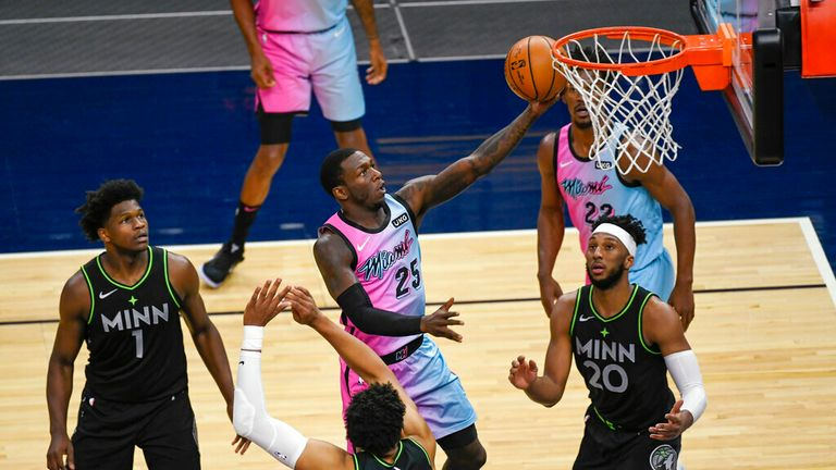 AP - Miami Heat guard Kendrick Nunn (25) goes up for a shot past Minnesota Timberwolves guard Anthony Edwards (1), center Karl-Anthony Towns (32) and forward Josh Okogie (20)