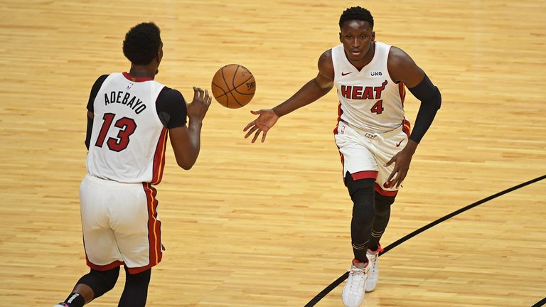 Victor Oladipo hands off to Bam Adebayo for the Miami Heat